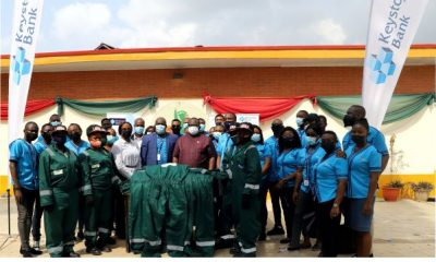 Keystone Bank trainees donate street sweepers' uniforms to LAWMA