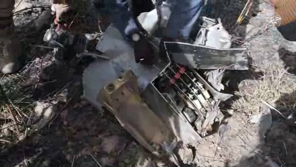 Insurgents removing aircraft component