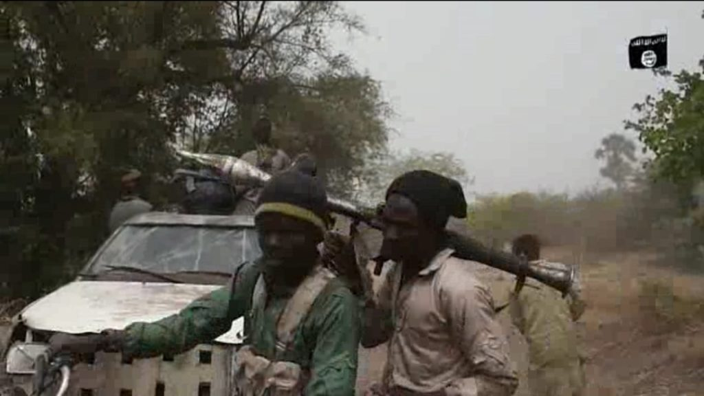 Fighter with an RPG-backed Boko Haram gun truck.